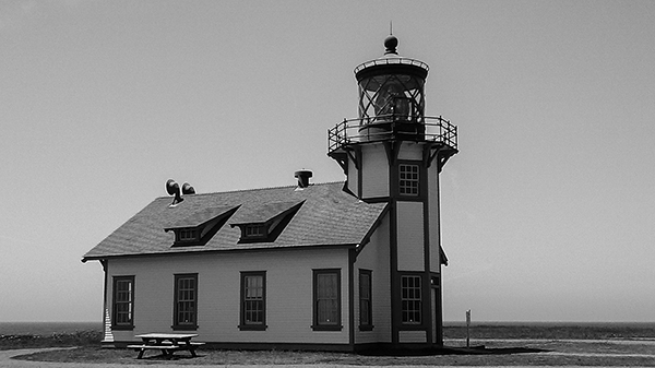 Black and white photograph of the Point Cabrillo lighthouse in California, taken by K. Bradley Washburn